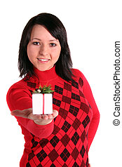Small Present - A young handsome woman handovers a small...