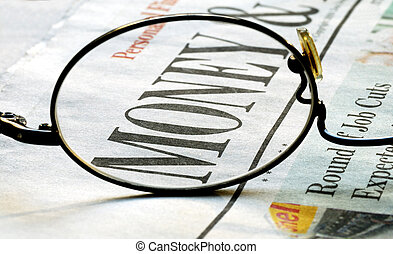 Focus on money investing on a newspaper