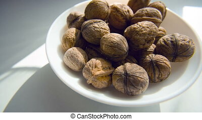 walnut in a plate on the white background - walnut in a...