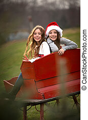 Two Sisters in Red Sleigh