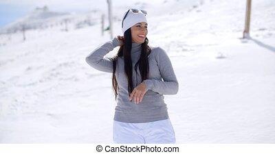 Beautiful woman laughing on ski slope - Single beautiful...