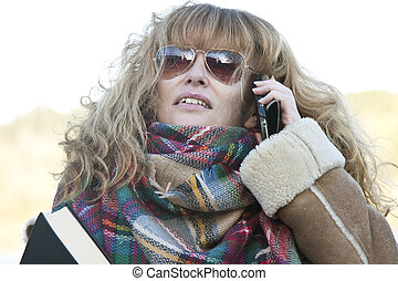 adult woman talking on phone outdoors