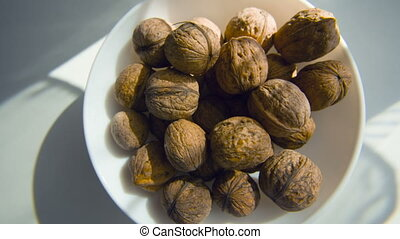 walnut in a plate on the white background