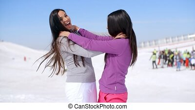 Joking women strangling each other - Pair of female friends...