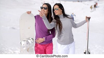 Two stylish women with their snowboards - Two stylish women...
