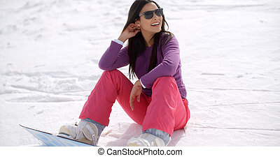 Gorgeous young woman using a snowboard