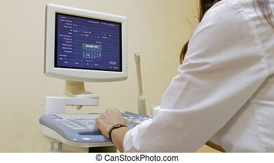 Medical Ultrasound Scanner - The Doctor Oversees The Work Of...