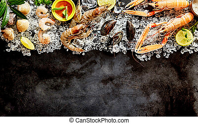 Fresh Seafood and Ingredients on Dark Background - High...