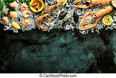 Fresh Seafood Chilling on Ice on Dark Background - High...