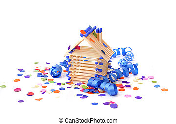 House-warming Party - A tinkered house within confetti and...