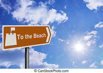photo realistic \'to the beach\' sign, against a sunny blue sky