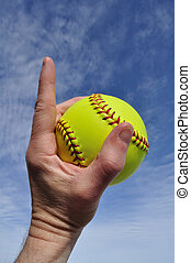 Softball - Number One - Player Gripping a Yellow Softball...
