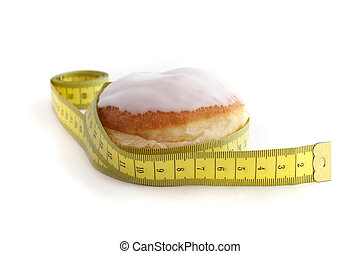 Thickener - A jelly donuts with measuring tape. All isolated...