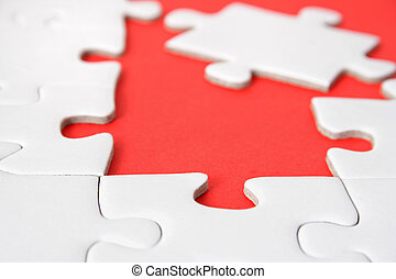 Open Vacancy - A jigsaw puzzle with a red gap.