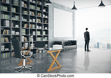 Businessman in modern personal office with big bookcase,...
