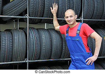 Trustful Worker - A trustful worker in a tire workshop **...