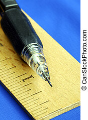 Ruler and pencil are tools for carpenters and architect