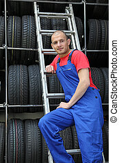 Motivated worker - A motivated worker in a tire workshop...