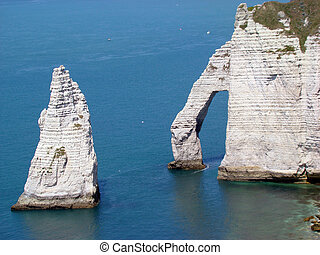 Etretat Aval Cliff, natural Rocks and Arch Landmark and blue...