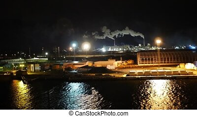 Factory with smoking pipe, night, riga, latvia