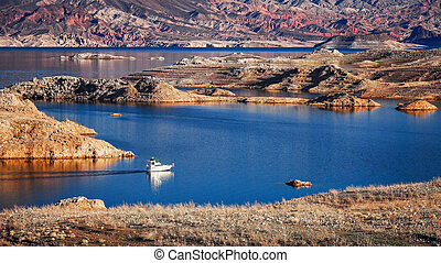 Boat on Lake Mead - A boat enters a narrow channel on Lake...