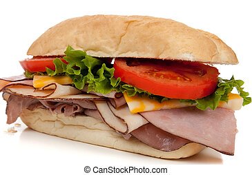 Ham and turkey sandwich on a hoagie bun on white - A ham and...