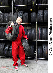Best Service - A motivated worker in a tire workshop...