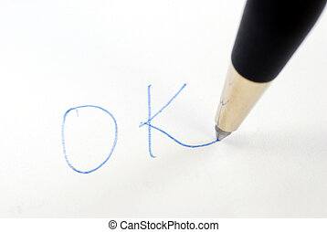 Write the word OK with a pen