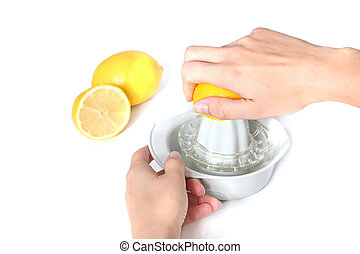 Vitamin C - A person cutting lemons. All isolated on white...