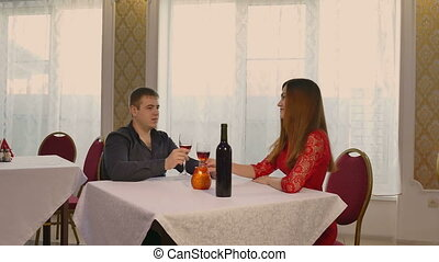 man and girl romantic woman evening in restaurant drinking...