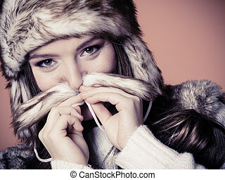 Woman in fur cap - Beauty and fashion of women Wintertime...