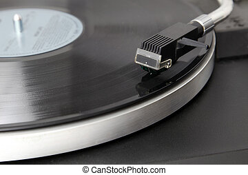 Record Player - A record player is playing an album.