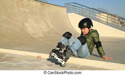 Young skater smiling to camera sho - Young boy in frond of a...
