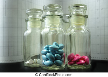 Glass bottles with colorful pills