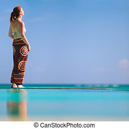 Girl on vacation - Beautiful woman relaxing by infinity...