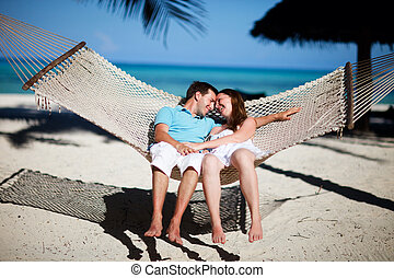 Tropical vacation - Young romantic couple relaxing in...