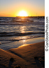 Sunset behind Larg\'s Bay beach and Jetty, Adelaide,...