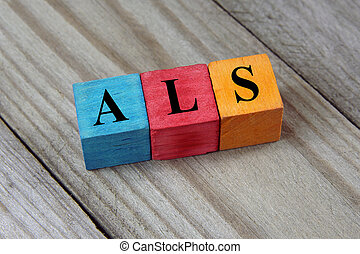 ALS Amyotrophic Lateral Sclerosis acronym on colorful wooden...