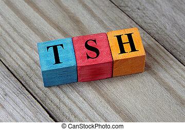 TSH (Thyroid-stimulating hormone) symbol on colorful wooden...