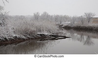 Heavy snow on the river. Winter weather