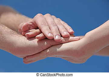 Cooperativeness - Some people putting her hands together in...