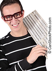 Nerd - A typical nerd holding a keyboard. All isolated on...