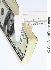 Money Measuring - Bundle of one hundred dollar notes and...