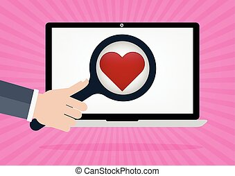 Human hand hold a magnifying for find love and heart icon on...