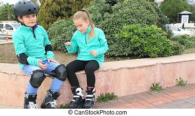 Boy and girl with roller skate - Portrait of a happy ,cute...