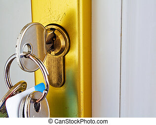 mortgage - keys in a modern lock mortgage concept