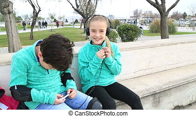 Young girl with headphones - Happy cute schoolboy and...