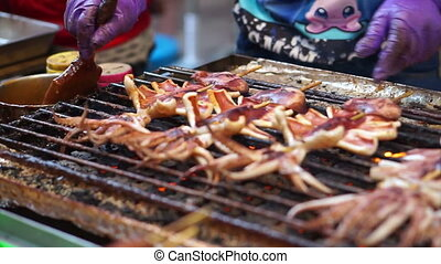 Grilling squid, Street Food night - Grilling bbq squid,...