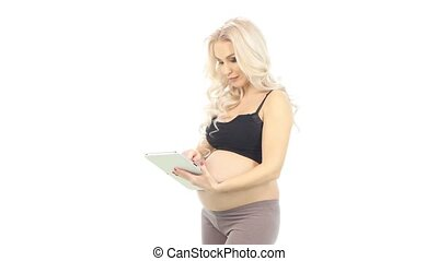 Young pregnant woman with tablet, white - Young pregnant...