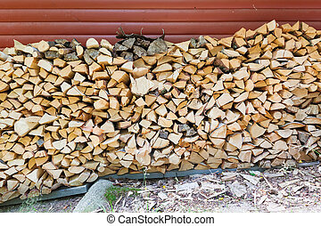 Firewood pile stored outside